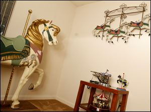 Lynn Burns' bedroom is fully decorated with carousel horses.
