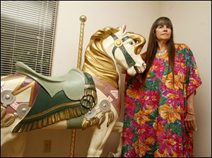 Lynn Burns calls her hollowed-out replica carousel horse
