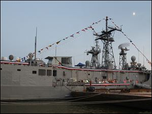 The moon shines over the U.S. Navy frigate USS De Wert, docked in Toledo.