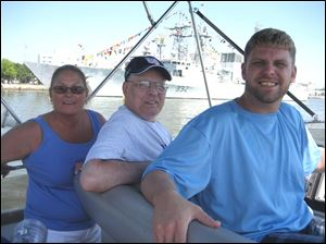 Laura Studyvin, from left, Mike Cully, and JR Cousino on the harbor View Yacht Club's annual Maumee River cruise for developmentally disabled adults.