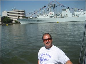 Mike Wiseman cruises by the Canadian ship Ville de Quebec, docked at Maritime Plaza.