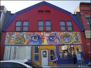 Mario Torero has painted his trademark 'Picaso's Eyes' in Lima, Peru, and San Diego, as well as above the door of Joe Martinez's studio on Broadway.