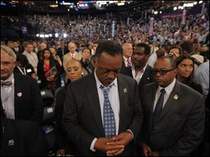 Rev. Jesse Jackson prays during benediction at the Democratic National Convention.