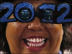 North Carolina delegate Tiffany Peguise-Powers fashions her glasses at the Democratic National Convention.