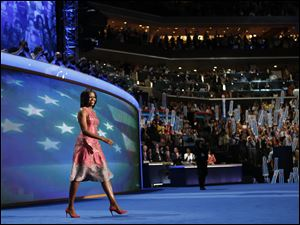 First Lady Michelle Obama takes the stage.