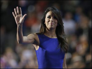Obama Campaign Co-Chair Eva Longoria waves after addressing the delegates.