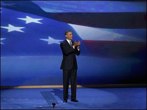 President Barack Obama stands on stage after addressing the Democratic National Convention.