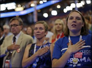 Delegates recite the Pledge of Allegiance at the Democratic National Convention.