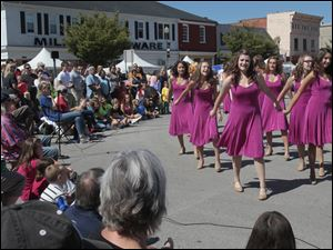 Perrysburg High School's Women's Select Show Choir performing at the festival.    A festival brings out a crowd in downtown Perrysburg.