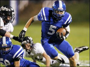 Anthony Wayne running back Sam Bruno (5) runs the ball.