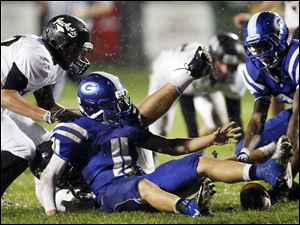 Anthony Wayne running back Josh Schwerer (11) fumbles the ball.