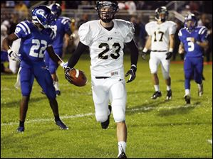 Perrysburg wide receiver Austin Bishop (23) scores a touchdown.
