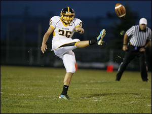Nate Bartlett, of the Northview Wildcats, punts the ball.