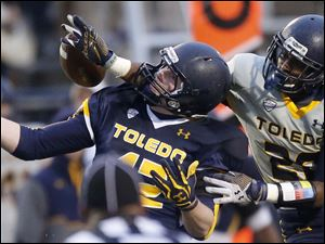 Toledo Rockets gold team cornerback Juwan Haynes, 20, breaks up a pass intended for blue team tight end Craig Runyan.