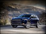 This undated product image provided by Chrysler shows the 2014 Jeep Cherokee. The Cherokee will be built in Toledo.
