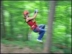 Images of Hocking Hills zip-lining.