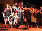 The cast of 3B Productions' presentation of 'Urinetown the Musical' rehearses for shows today through Sunday at the Maumee Indoor Theater.