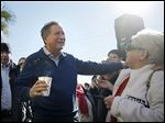 Gov. John Kasich meets the crowd outside a campaign stop in Pawleys Island, S.C., on Thursday. Republican presidential candidates have turned their attention to South Carolina, which will hold its primary on Feb. 20.