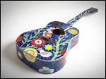 A mosiac guitar piece by Gail Christofferson will be on display at Treo during Sylvania's First Friday Art Walk.
