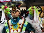 Nearly 3,000 indigenous dancers from across the United States and other countries participate in the first grand entry of the 33rd annual Gathering of Nations in Albuquerque.