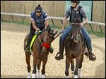 Kentucky Derby hopeful Nyquist, left, under exercise rider Jonny Garcia, walks the track at Churchill Downs next to assistant trainer Jack Sisterson. The horse is named after Gustav Nyquist of the Detroit Red Wings.