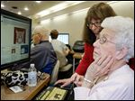 Janet Cribbs, 89, learns how to use a computer from Pat Nigro,  manager of outreach at the library.