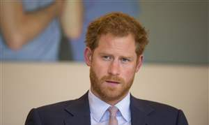 CORRECTION-Britain-Prince-Harry